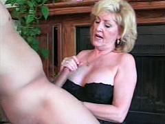 Horny blonde MILF kneels down and sucks cock