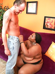 Horny ebony bbw Chocolat Hottie showing off her brown gazongas and spreading her fat cooze to...
