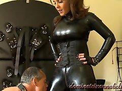 Dominatrix teasing her slave