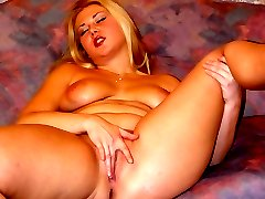 Busty blonde plays with her tits and then finger fucks her fat pussy in the living room