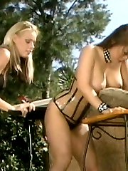 Mistress Nicole Sheridans paddles a horny asian slave in this steamy outdoor bdsm spanking
