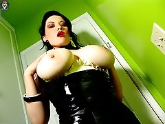 Big breasted Gothic fetish girl shows her nice tits