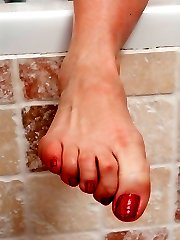 Tammy relaxed and horny in her soapy bath flaunting her red toenails and bare feet!