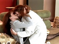 Redhead MILFS kiss before licking and fingering each others tight little holes
