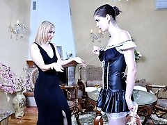 Hot gal in maid uniform gets spread on the table by a strap-on armed lezzie