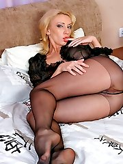 Blondie in black pantyhose exploring her nyloned slit with probing fingers