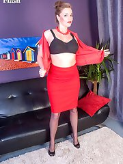 Holly dressed in black full fashion nylons, matching heels and dressed in racy red snug fitting...