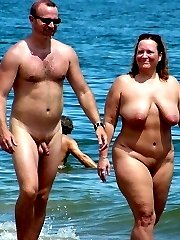 Voyeur pics of lovers making love in the at their local nudist beach