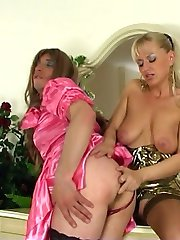 Dressed up sissy guy getting pumped up the ass by a strap-on armed woman