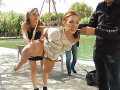 Mona Wales has found a filthy little panty sniffer that needs to atone for sinning with her whore holes. Pamela Sanchez's atonement begins by being publicly suspended in rope bondage with her sinful cunt exposed. A crowd gathers around Pamela as Mona and Steve Holmes use her mouth as an ashtray. As more men approach Pamela to photograph her spread pussy, Mona canes Pamela's bare feet till she wales in pain. Satisfied with the first part of Pamela's atonement Mona takes her to a bustling Barcelona market where she strips Pamela naked and pushes her to bare her shameful body for everyone to see. Pamela hangs her head with embarrassment as women point and whisper and men stare. Pamela's final trial of atonement for being a filthy whore is public humiliation by sexual servitude. Mona and Steve open this bitches holes up for everyone to use. Pamela gets her ass pounded by a dick on a stick, as her throat is used by Steve's huge cock. Pamela's atonement ends with her completely used up in a pool of her own squirt, her braces caked with cum. Another public disgrace fantasy fulfilled.
