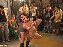 Two gorgeous slut pets are out on public patrol. Lead around by a leather leash, these nude slaves crawl around on the dirty floor on their hands and knees. Tied up in tight rope bondage, these eager pain sluts beg for corporal punishment for the amusement of a rowdy party. They scream so loud when they are hit with electric zappers and slapped hard on their bright red ass. The group gets their hands on these bondage bitches before they service them with deep throats and hard fucking. Even the crowd gets naked as they cheer for huge loads of cum to drench these beautiful women.