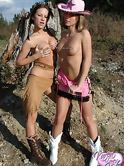 Kate and Karen play cowboys and indians outdoors in the forest ripping off each others costumes