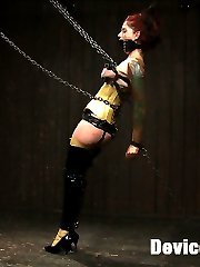 Tricia looks stunning in yellow latex all chained up with her breast squashed by metal bars. We...