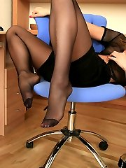 Smashing looking secretary learning to take her cup with her nyloned feet