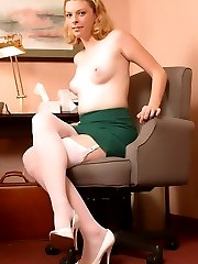 Nikki in white stockings at her desk