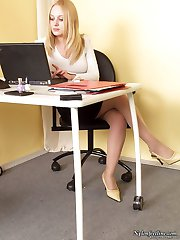 Raunchy secretary dangling her stiletto heel shoes and giving nylon footjob