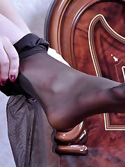 Nylon loving babe tries to choose the best fitting pair of hose for tonight