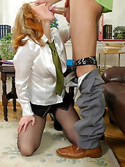 Red hot secretary spreading her pantyhosed legs while seducing her coworker