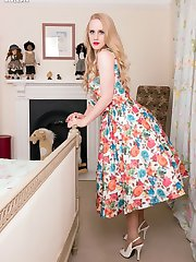 Lucy in a delightful floral full skirted dress, lacy petticoat and a sweet pale blue girdle!