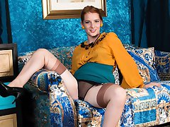 Jessica looks hot in her retro office uniform, sporting some outstanding fully fashioned nylons with eye catching welts!
