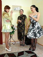 Three lesbian babes make pyramid while sliding their hands into shiny hose