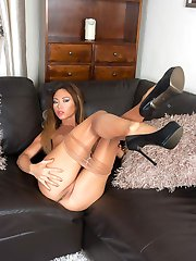 Here's Natalia in a pair of shiny sheer pantyhose, high class designer heels and a clingy mini dress.
