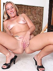 Mature blond babe Sky pulls panties down over tan lined ass.