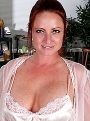 Busty housewife Brandie Jones toying her hungry pussy.
