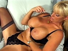 This big titted blonde MILF loves sucking and fucking