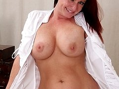 Redhead secretary Brandie Jones spreads MILF pussy on desk.