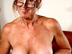 Busty older secretary Jenna Covelli strips after work.