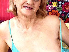 Horny granny Clara dildos her older pussy.