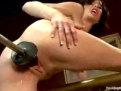 Brunette fucks machine and squirts splits over the bed frame