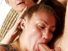 Mature slut riding her mouth and pussy up and down longhaired macho's firm cock
