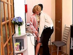 Blonde mom in strict office uniform and sexy stockings takes young meat right at her work