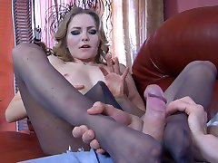 Charming girl lures her boyfriend into a fuck with her playful nyloned feet
