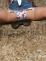 cowgirl in boots and stockings flashes her panties