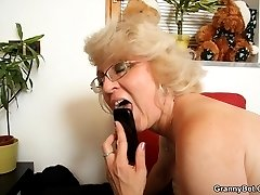 The granny pussy is pink and wet and it wants the hard young dick to penetrate it deeply