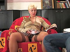 Stacked milf teases a cute guy with her upskirt look craving for his boner
