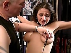 Slave in thick leather collar gets her tender nipples clamped and teased with a dildo