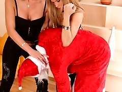Two seductive horny girls turn Santa Claus into submissive helpless slave
