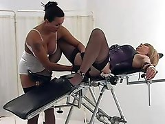 Strapon Jane fingering and fucking a crossdressers ass with a dildo
