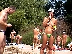 Cute babes swim and sunbathe topless or absolutely naked
