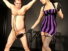 Dahlia strings up her submissive in preparation for him to entertain her. Dahlia is clearly in...