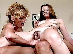 Lesbian blonde finger fucking hairy brunette pussy