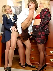 Sissy guy getting under anal assault by horny strap-on armed babes at work