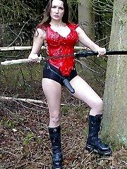 Strapon Jane posing outdoors with samurai sword