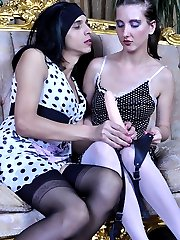 Dressed up and made up sissy sucks a fake dick and opens his ass for a girl