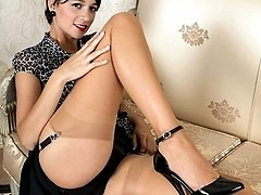 Tracy peels off down to sheer nylons and heels, transparent panties falling to the floor.