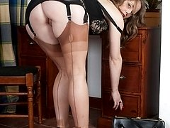 Naughty secretary plays in her vintage lingerie and tan nylons!